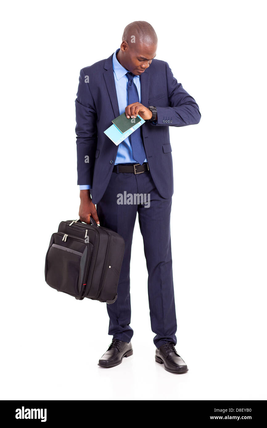 african american business traveller checking flight time Stock Photo