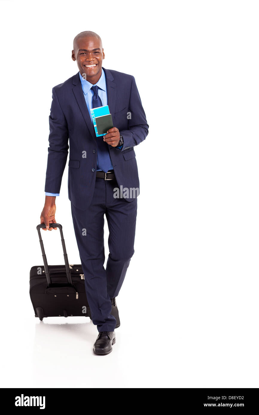 african american business traveller walking on white - Stock Image