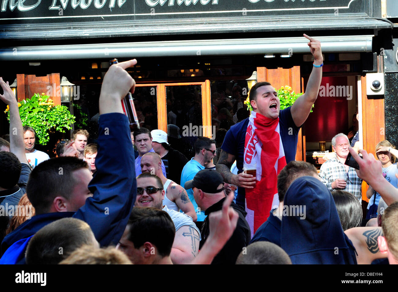 London, UK. 27 May 2013.. EDL protesters shout anti-Muslim slogans outside a pub in Leicester Square. Credit: Yanice - Stock Image