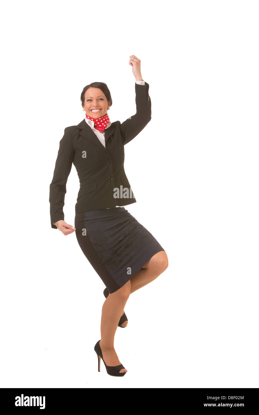 Happy and successful businesswoman with formal clothing and high-heels isolated on white background - Stock Image