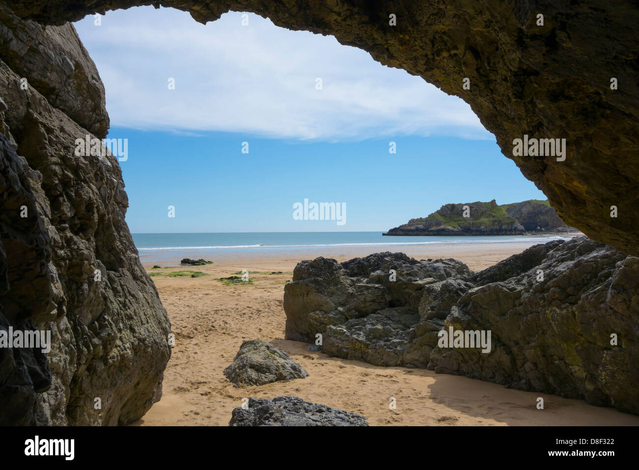 View of Broad Haven Beach from inside of a cave, at Bosherston, on the Pembrokeshire Coast National Park. - Stock Image