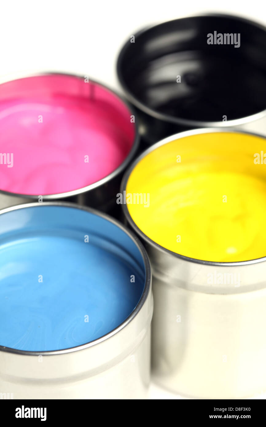 CMYK cans of paint - Stock Image