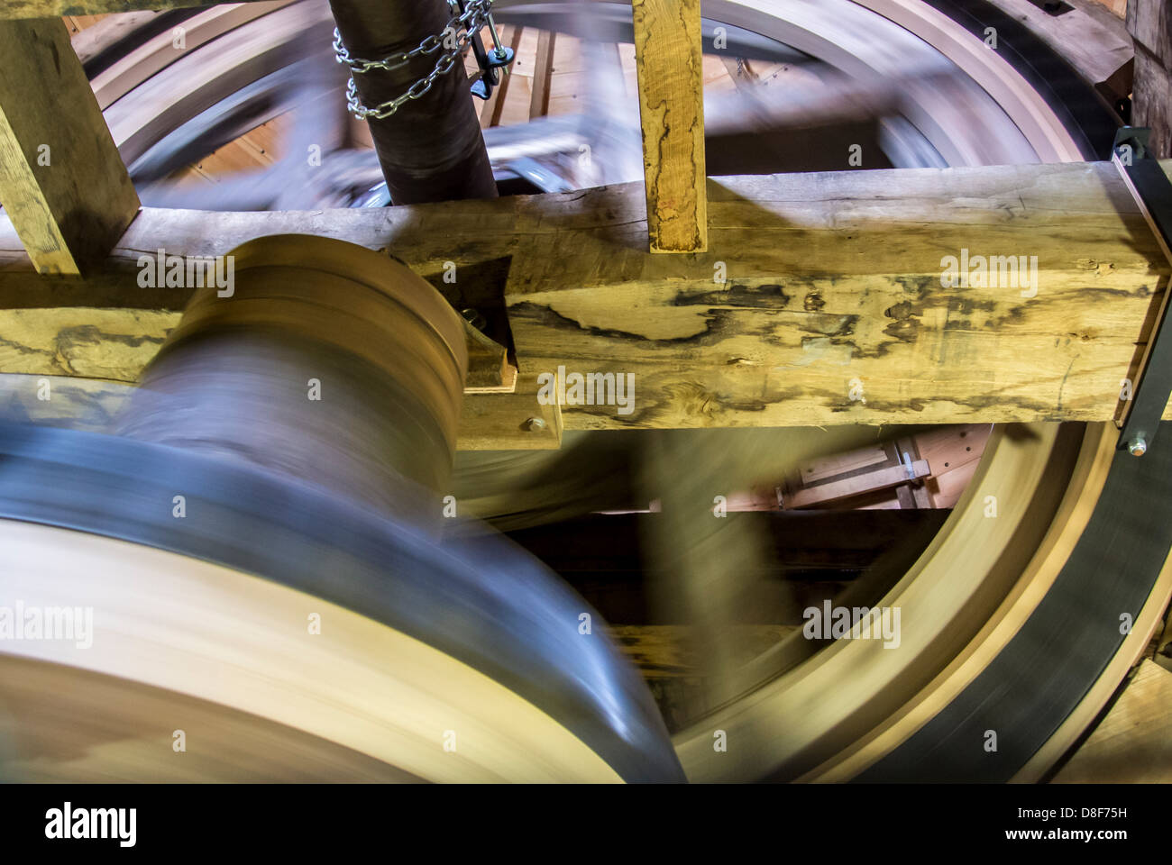 Cog wheels and bearing on sails in cap at Holgate Windmill, York, UK - Stock Image