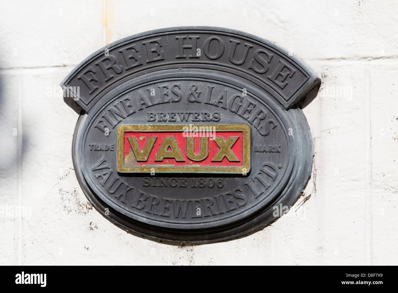 Old cast sign for Sunderland 'Vaux' breweries on a hotel wall in Warkworth, Northumberland - Stock Image
