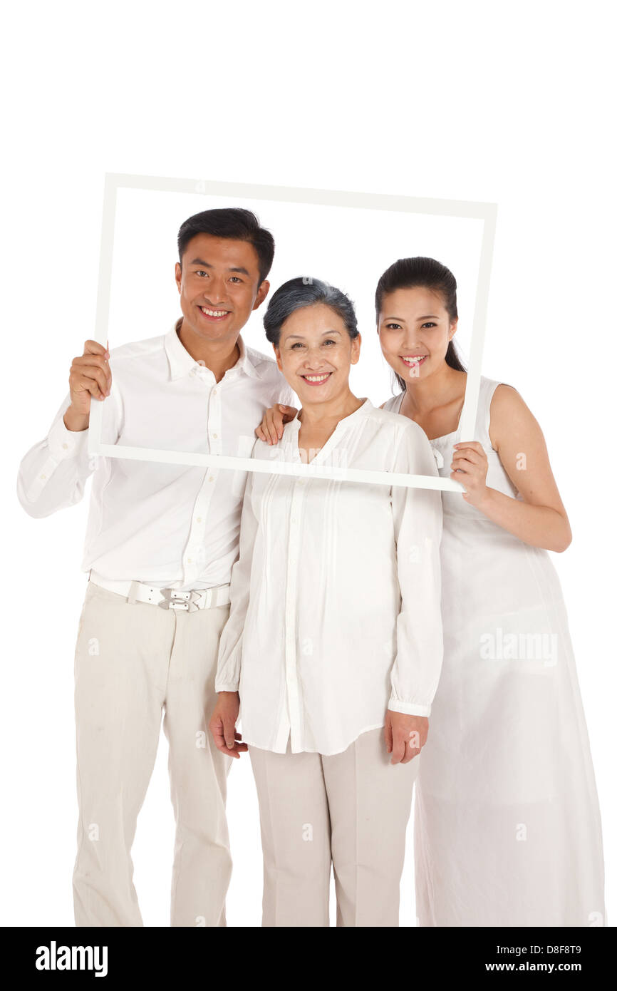 Mother,son and daughter holding photo frame Stock Photo: 56884585 ...