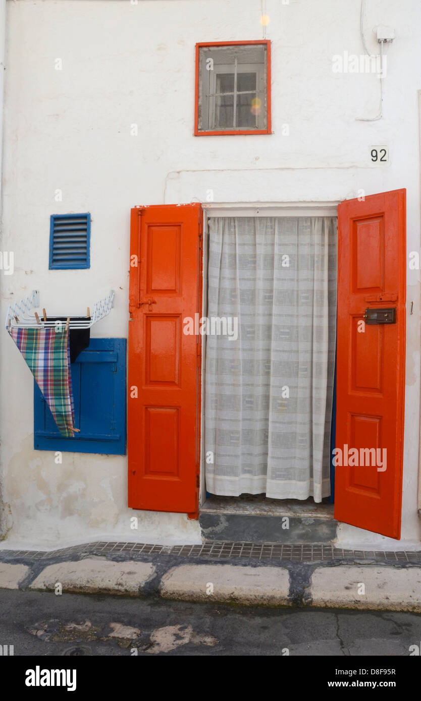 Red doors, Polignano a Mare, Italy - Stock Image