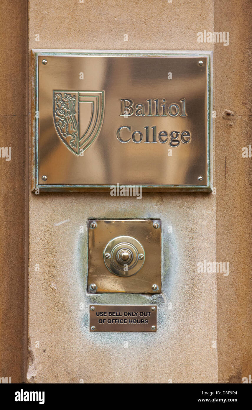 Balliol College plaque and door bell use bell only out of office hours at Oxford in May - Stock Image