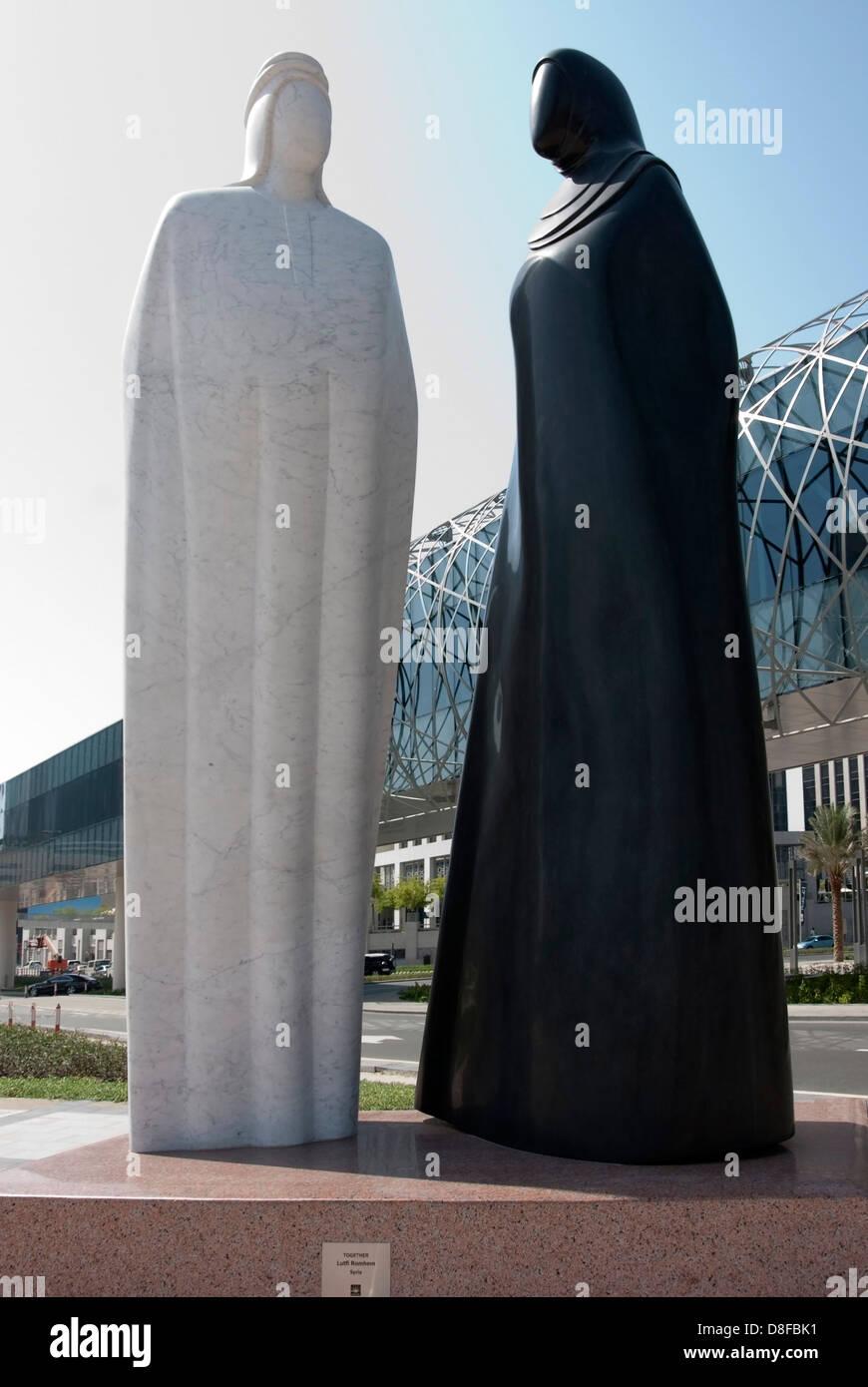 "Granite Sculpture of Arab Man & Woman ""Together"" by Lutfi Romhein Stock Photo"