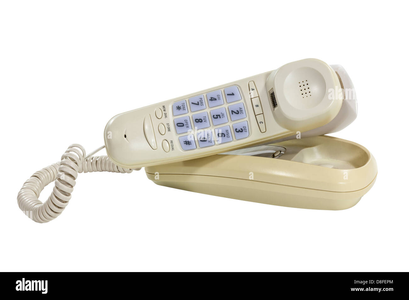 Funky old phone with neck holder attachment and clipping path. - Stock Image