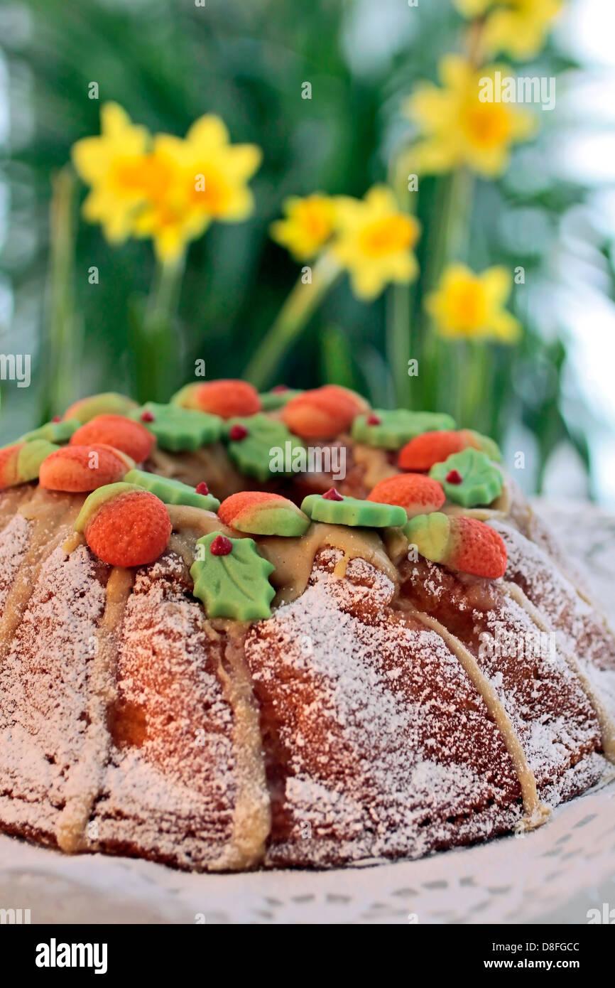 Birthday Bundt Cake And Yellow Daffodils Decoration Stock Photo