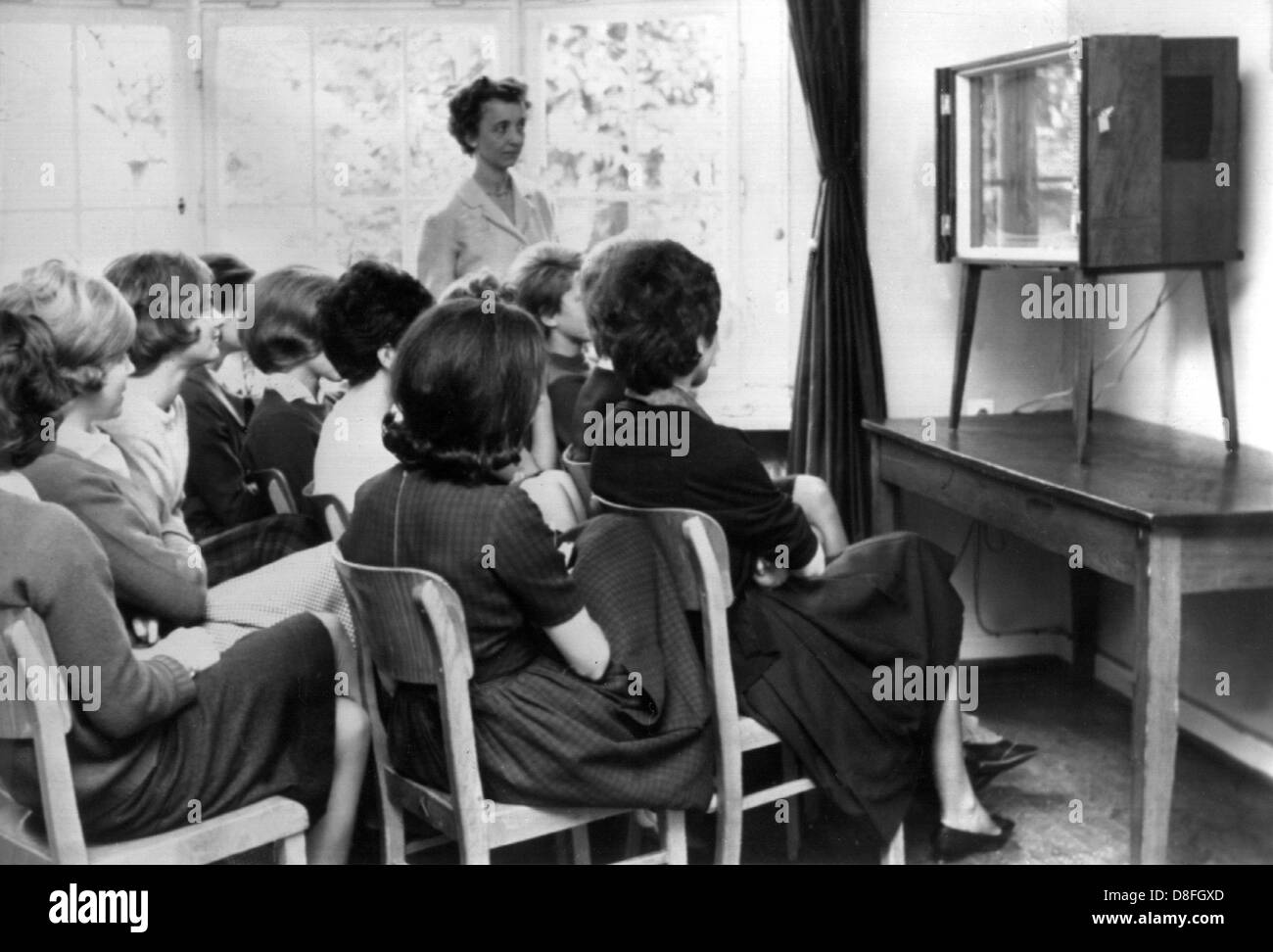 For the first time, German pupils are watching television during a school lesson on the 23rd of October in 1961. Stock Photo