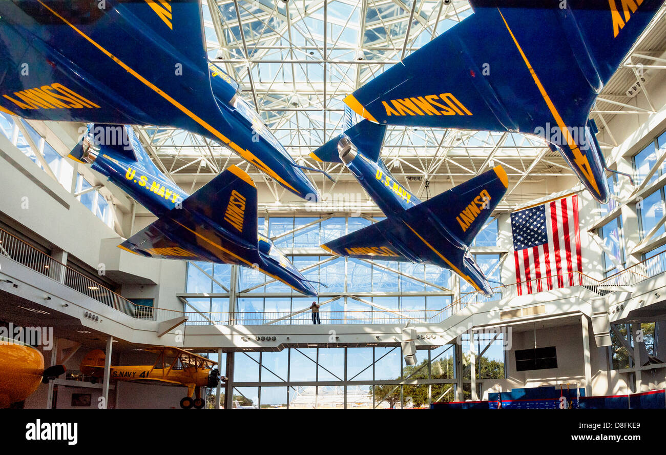 The meeting hall with jets hanging over head. At the National Naval Aviation Museum, Pensacola Florida. - Stock Image