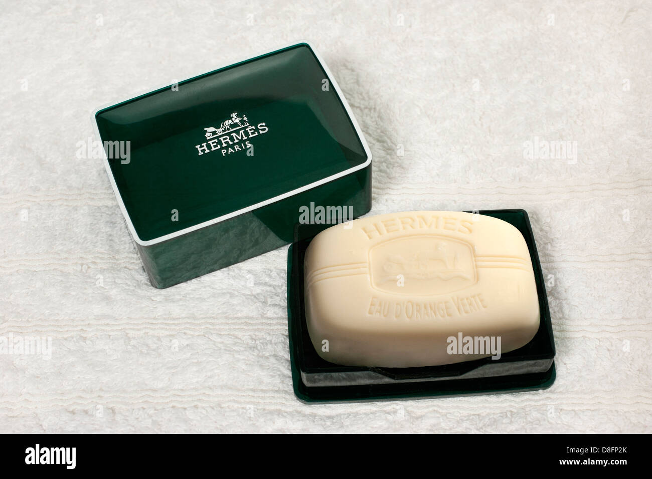 Luxury bar of perfumed hand soap by Hermes on a white towel - Stock Image