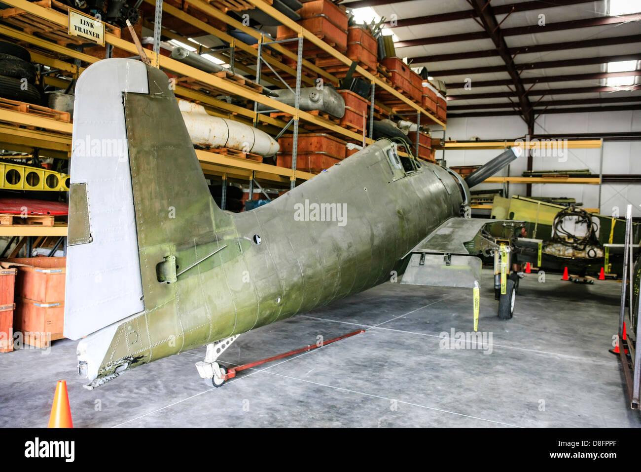 A semi-restored Hellcat in the Storage Hangar at the Fantasy of Flight Museum FL - Stock Image
