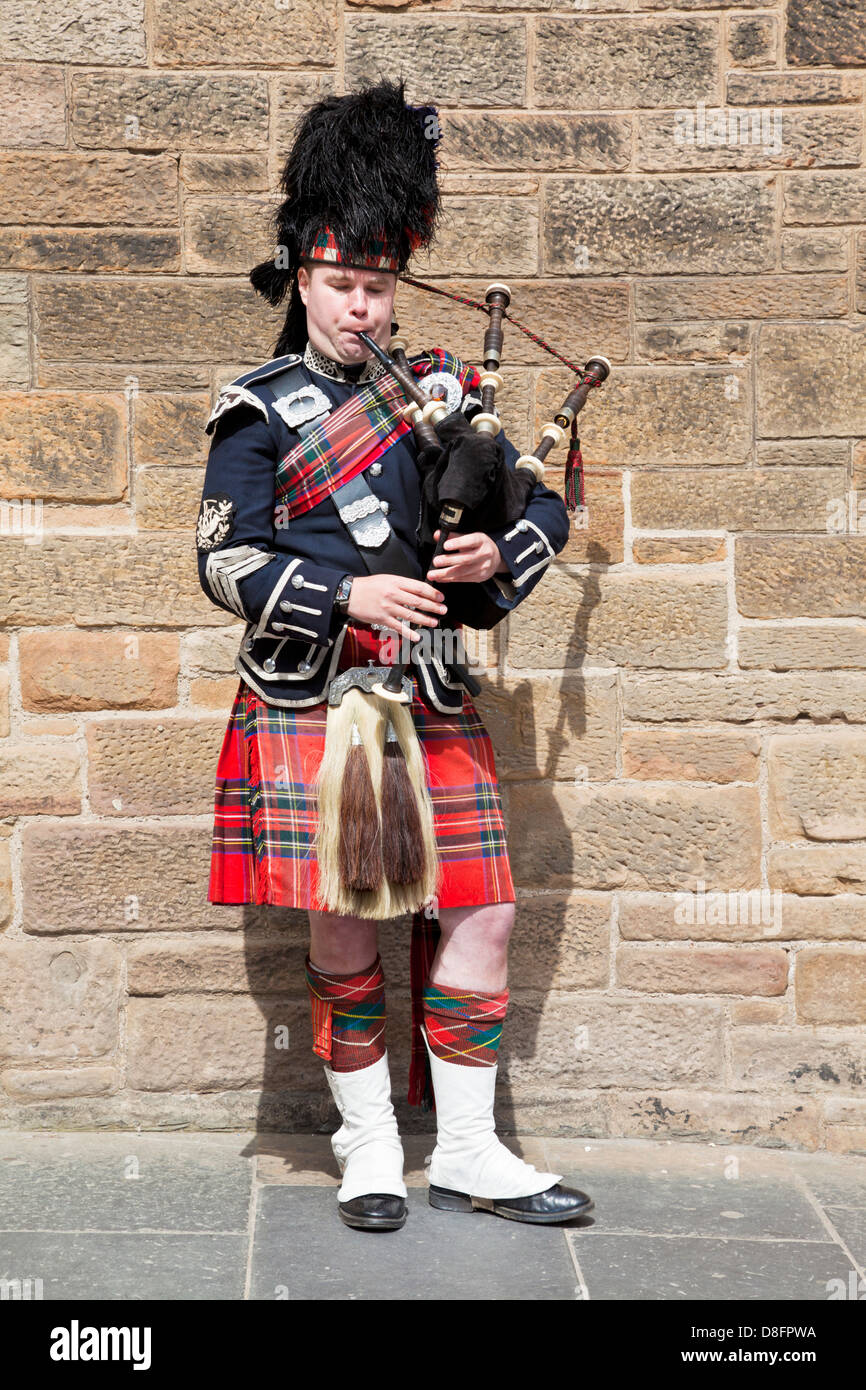 Scottish piper playing the bagpipes in traditional highland costume Edinburgh Scotland UK GB EU Europe - Stock Image