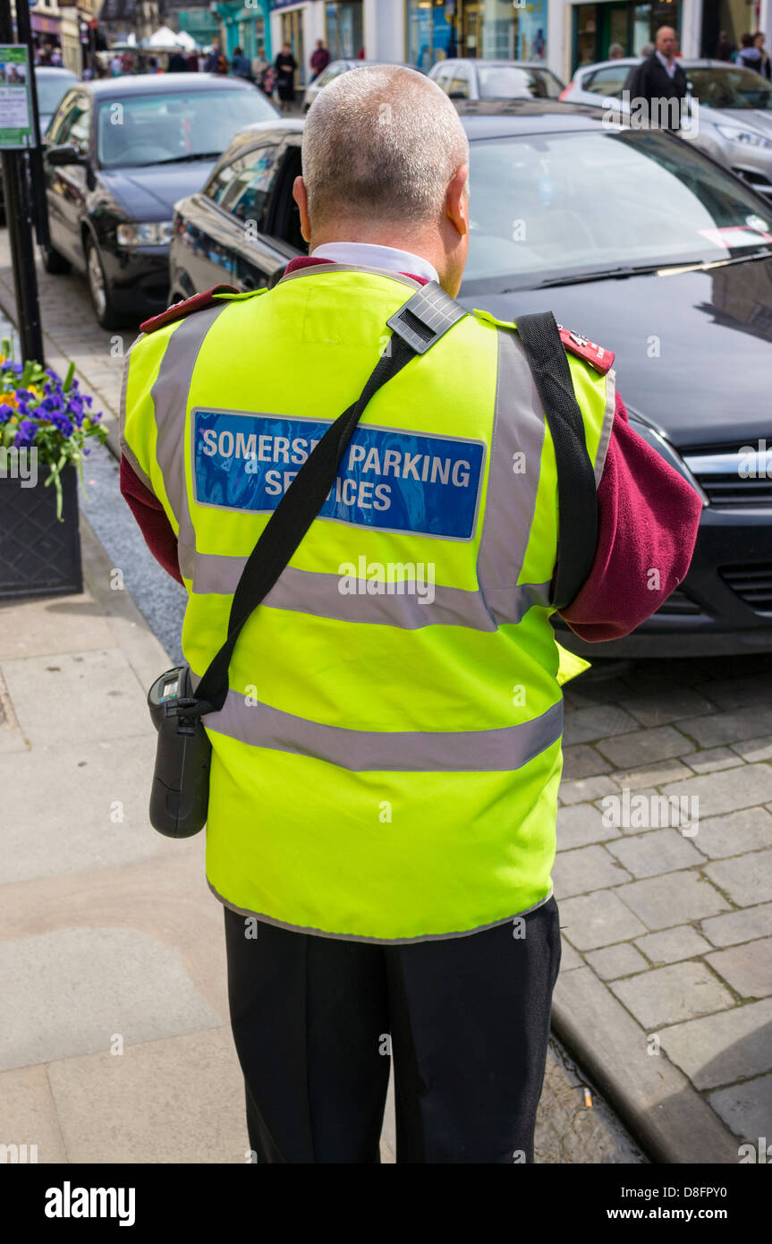 Traffic warden writing out a parking ticket, England, UK - Stock Image