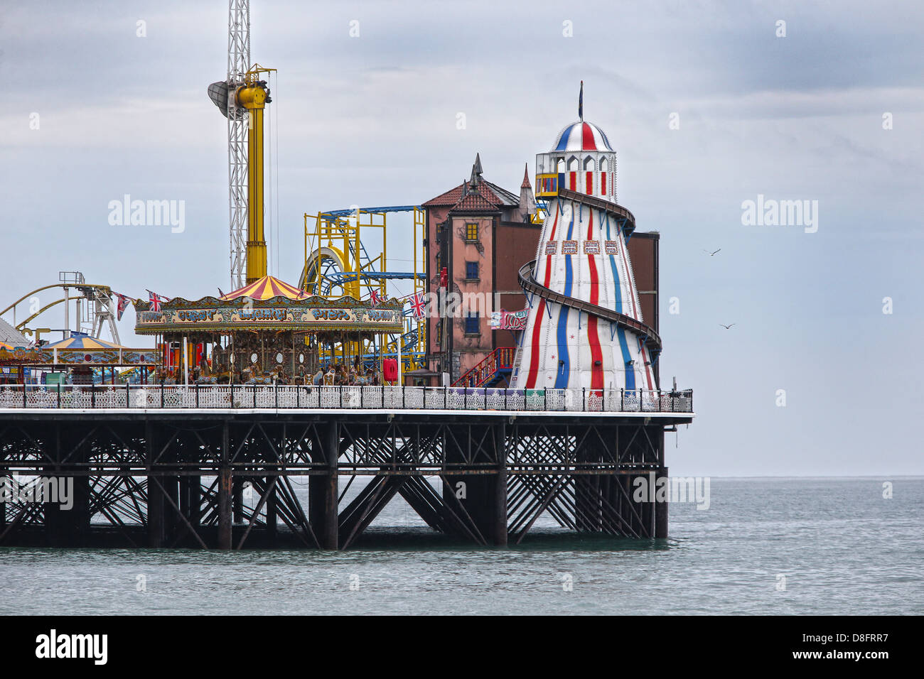 Helter Skelter and Merry go round on Brighton Pier. Stock Photo