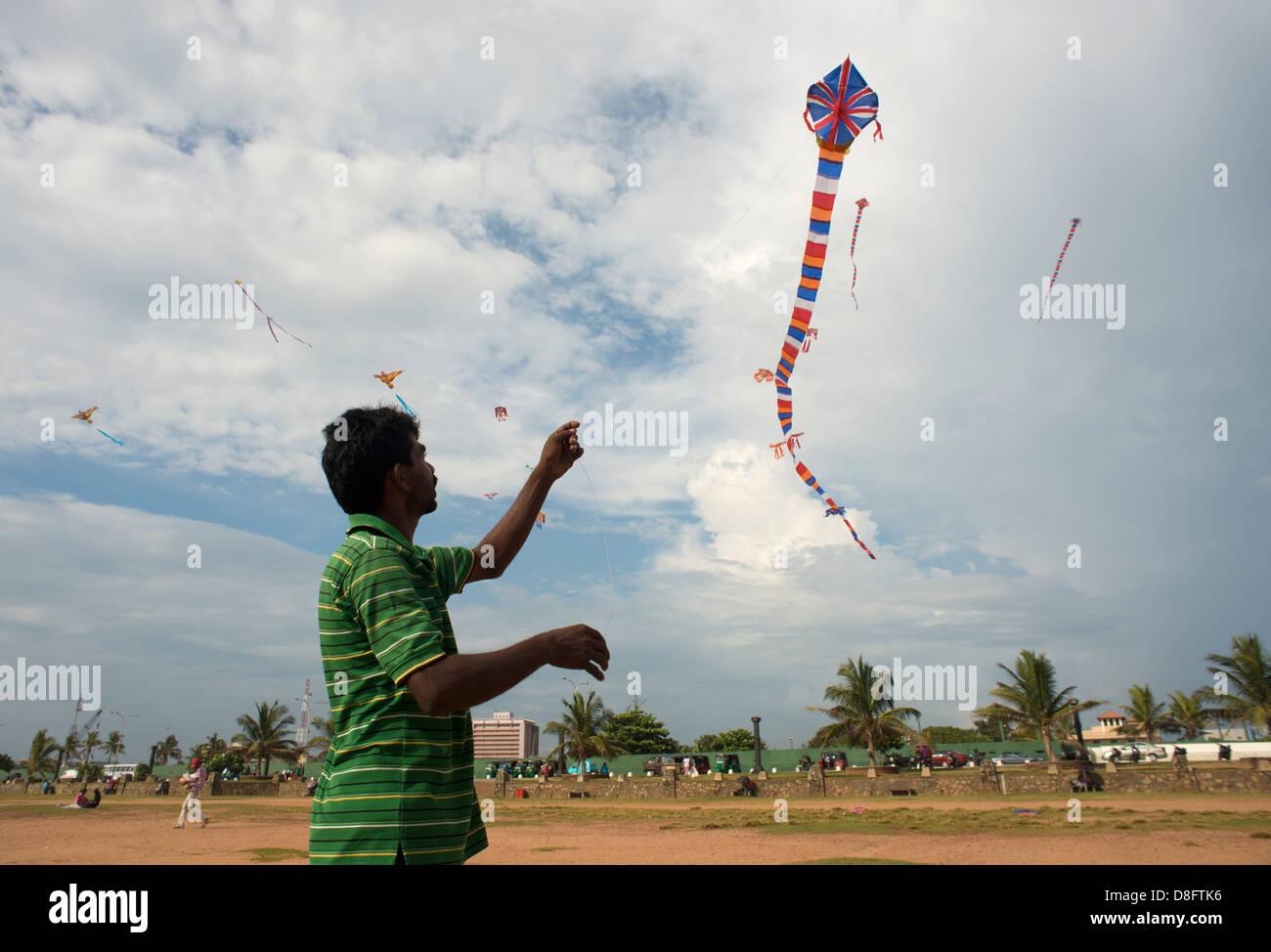 Man flying kite, Colombo Stock Photo
