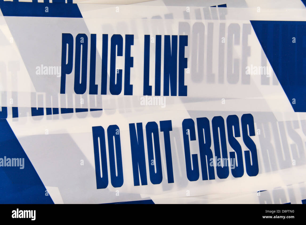 Police Line (Do Not Cross) tape from the United Kingdom (UK). May 2013 - Stock Image