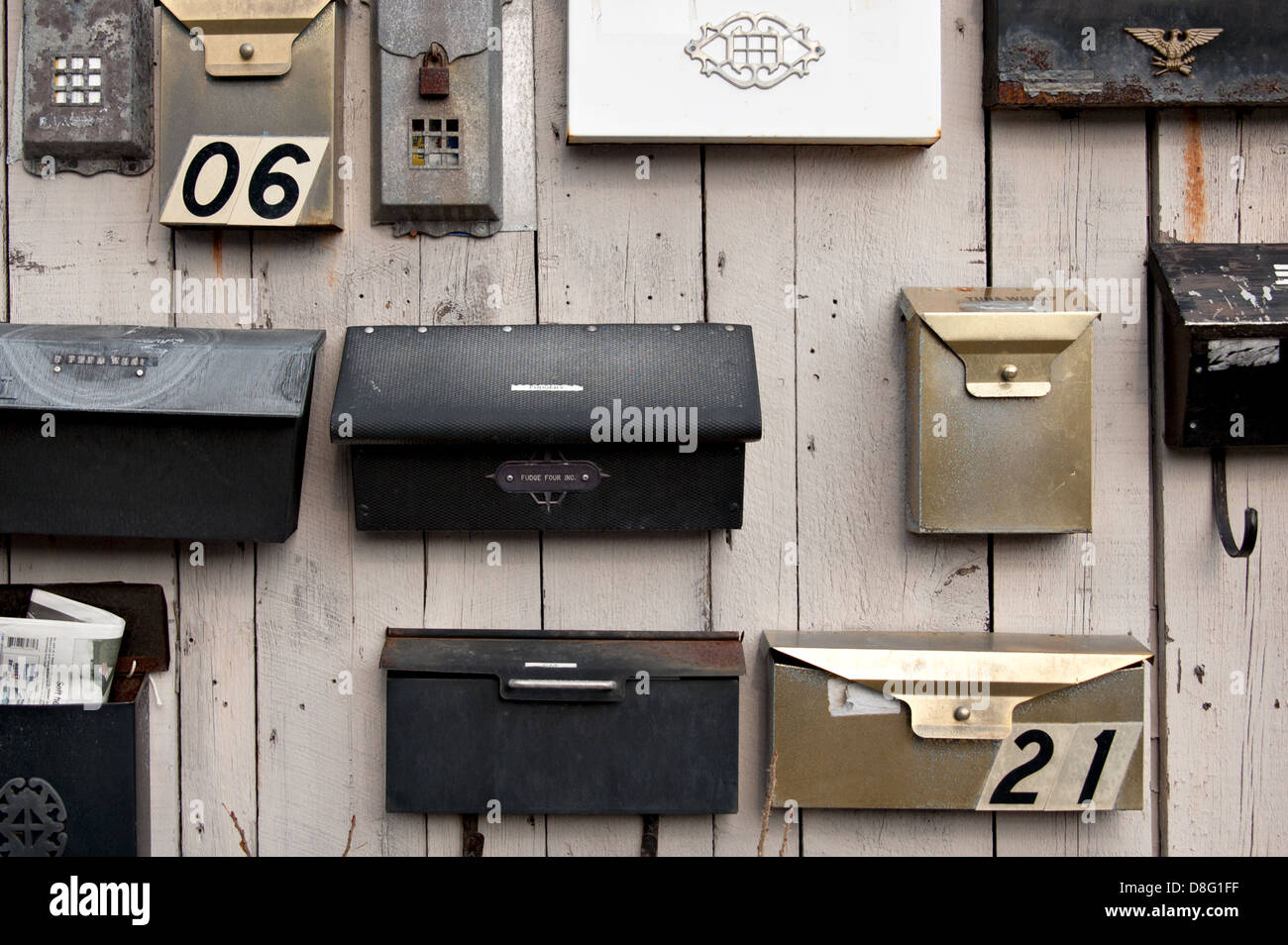 Many mailboxes on a wall. - Stock Image