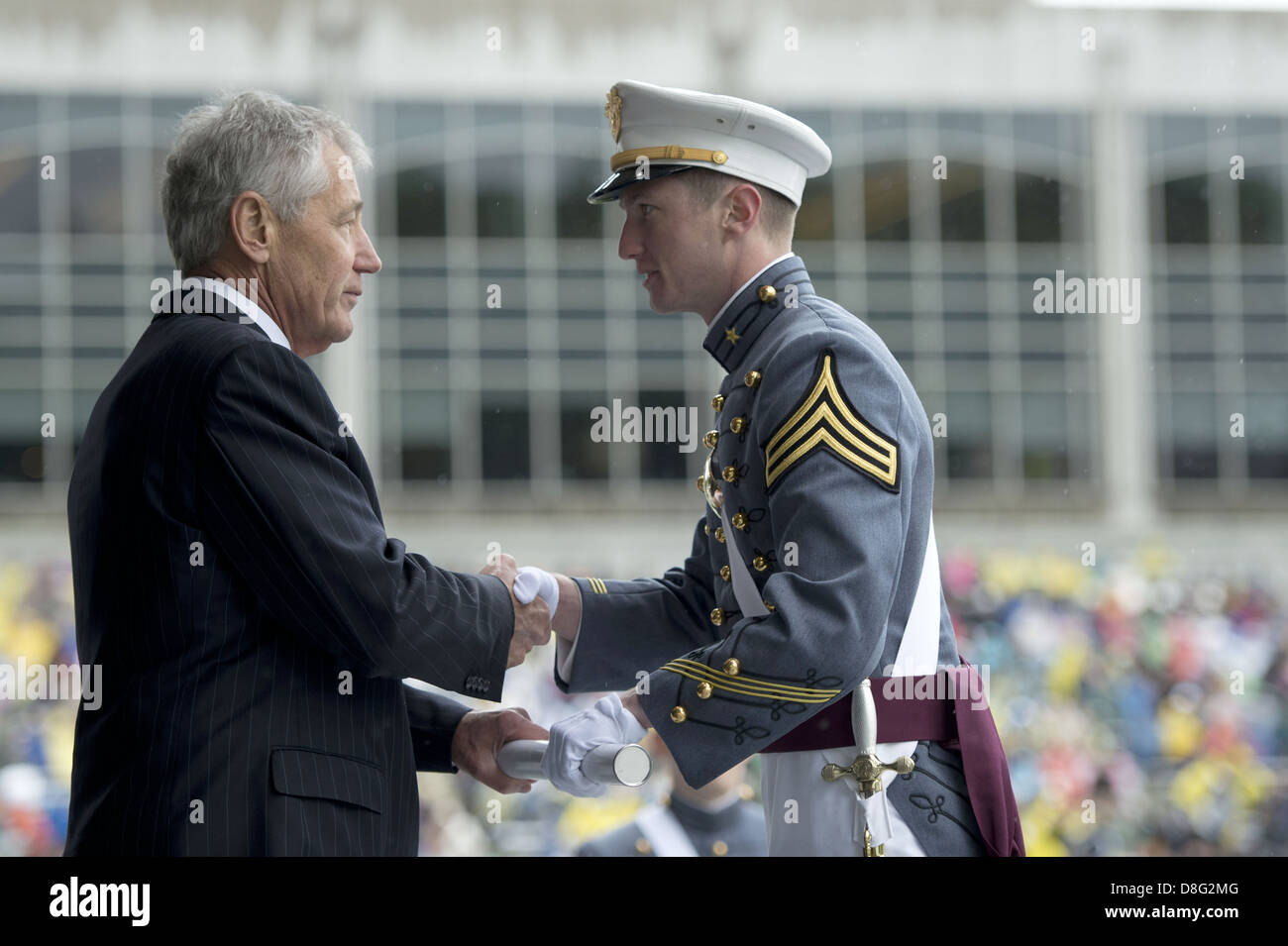 US Secretary of Defense Chuck Hagel presents an honor graduate with a diploma at the commencement ceremony for the - Stock Image
