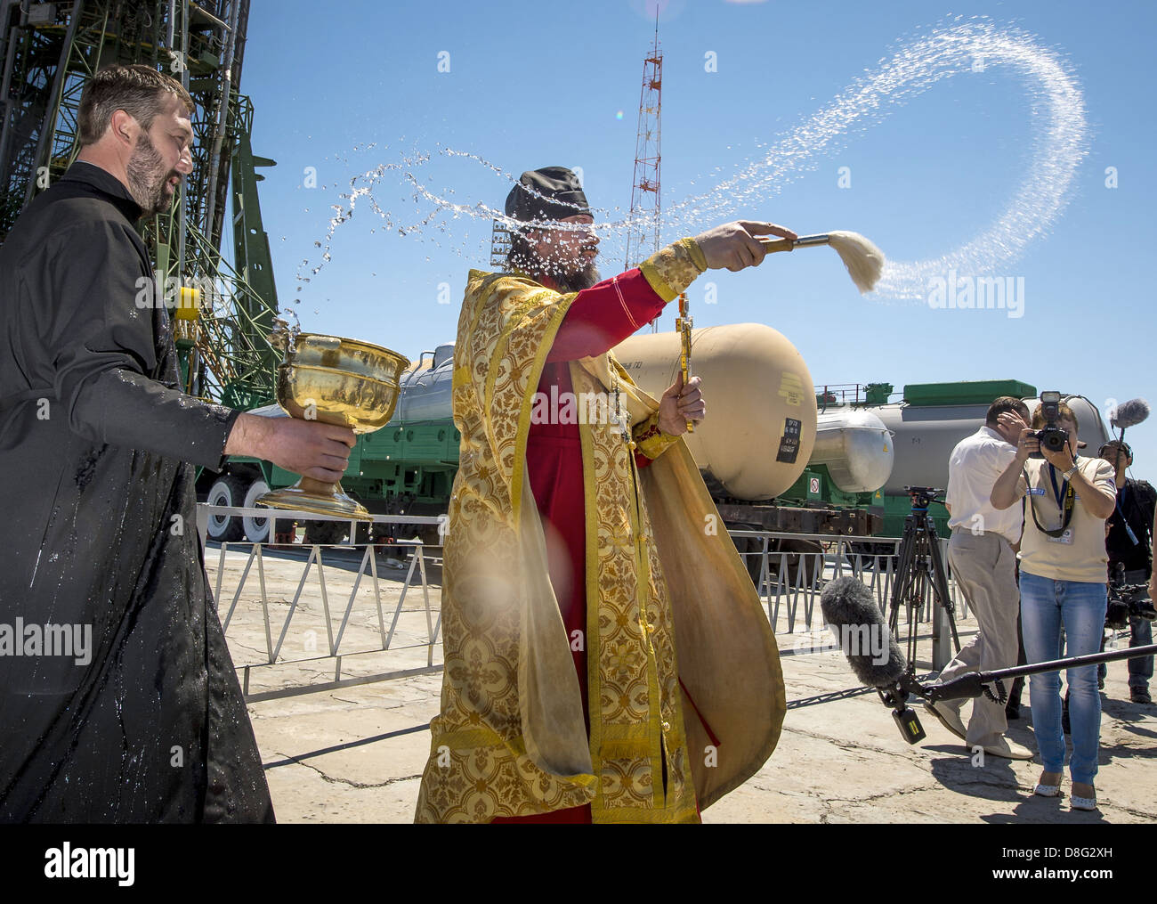 A Russian Orthodox Priest blesses members of the media shortly after having blessed the Soyuz rocket at the Baikonur Stock Photo