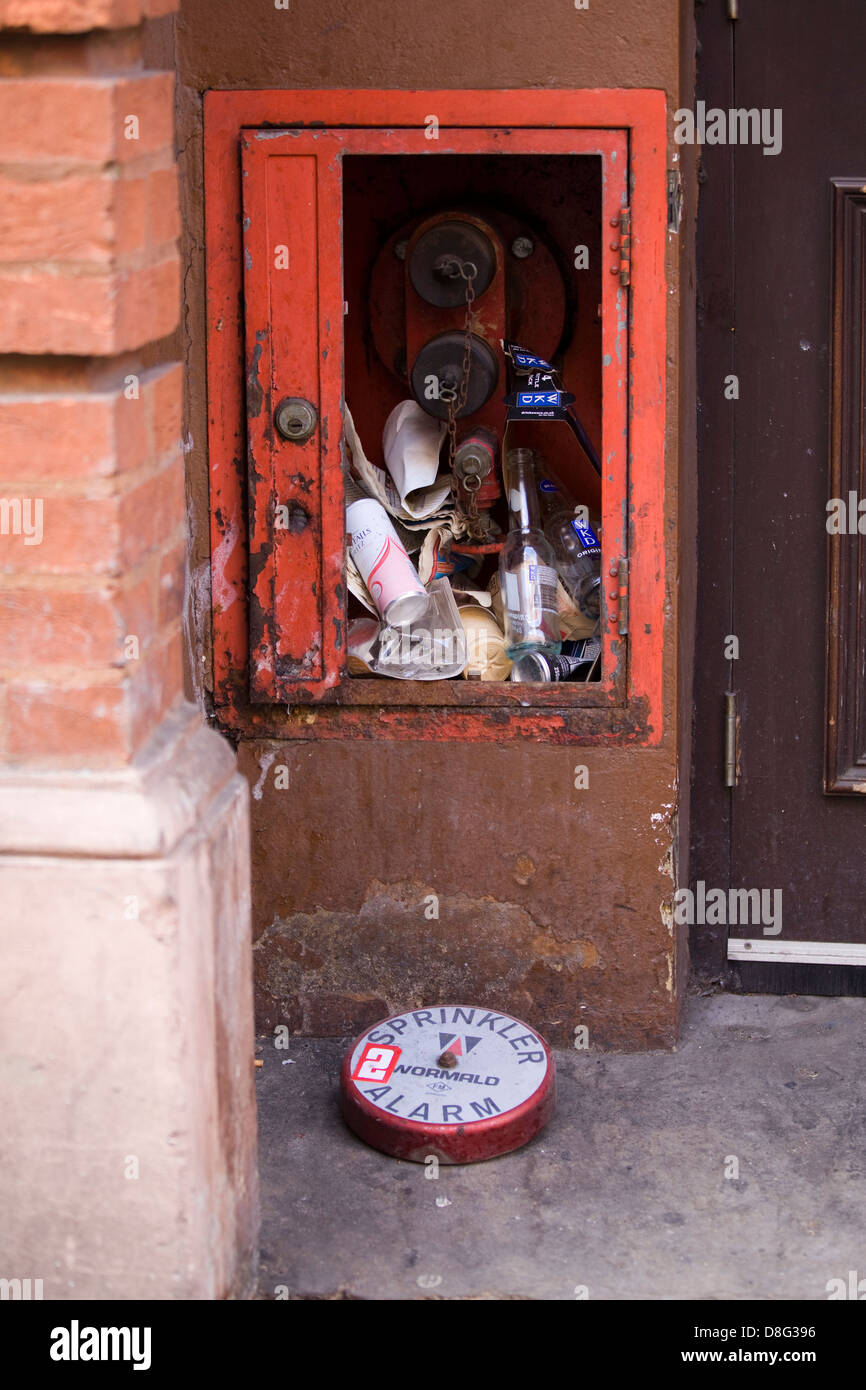 Sprinkler Alarm box and cover filled with Rubbish - Stock Image
