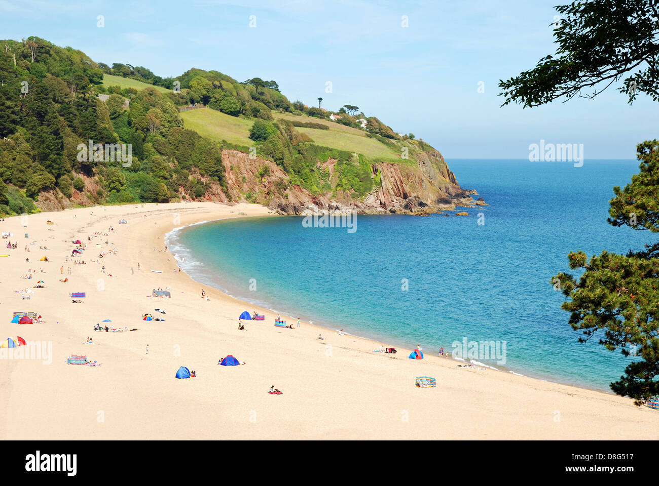 A sunny day at Blackpool sands near Dartmouth in Devon, UK - Stock Image