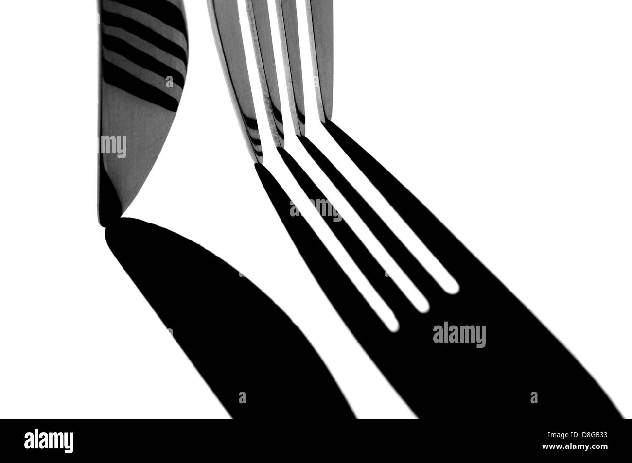 Black and white processed cut out image of cutlery. - Stock Image