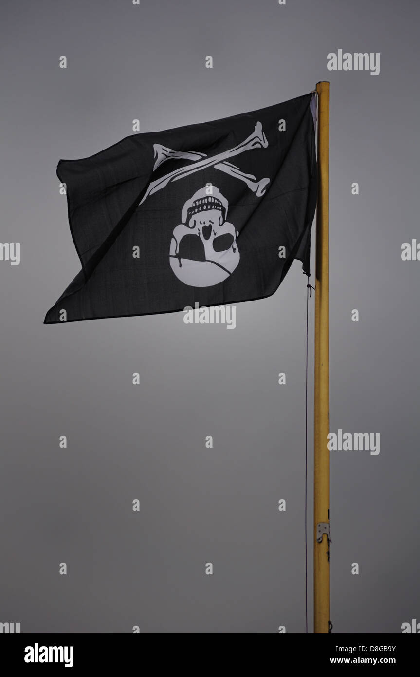 Pirate flag flown inverted - Stock Image