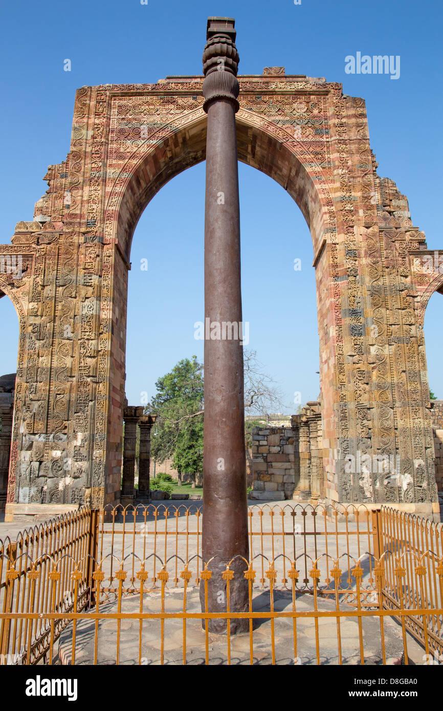 Iron Pillar at the Qutub Minar Complex, Delhi, India - Stock Image