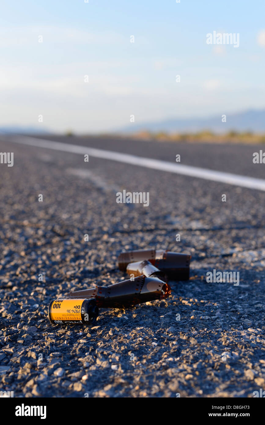 Discarded roll of film along the side of highway in the Great Basin region of Utah. - Stock Image