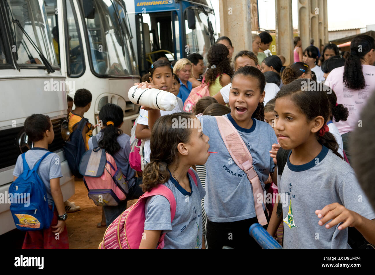 Brazilian school children on their way home from school. - Stock Image