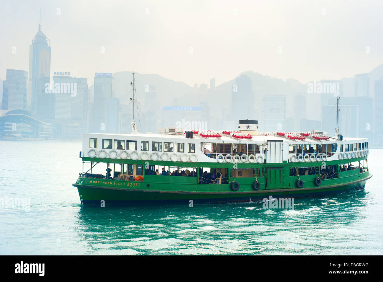 Ferry 'Solar star' on the way from Hong Kong to Kowloon island . - Stock Image