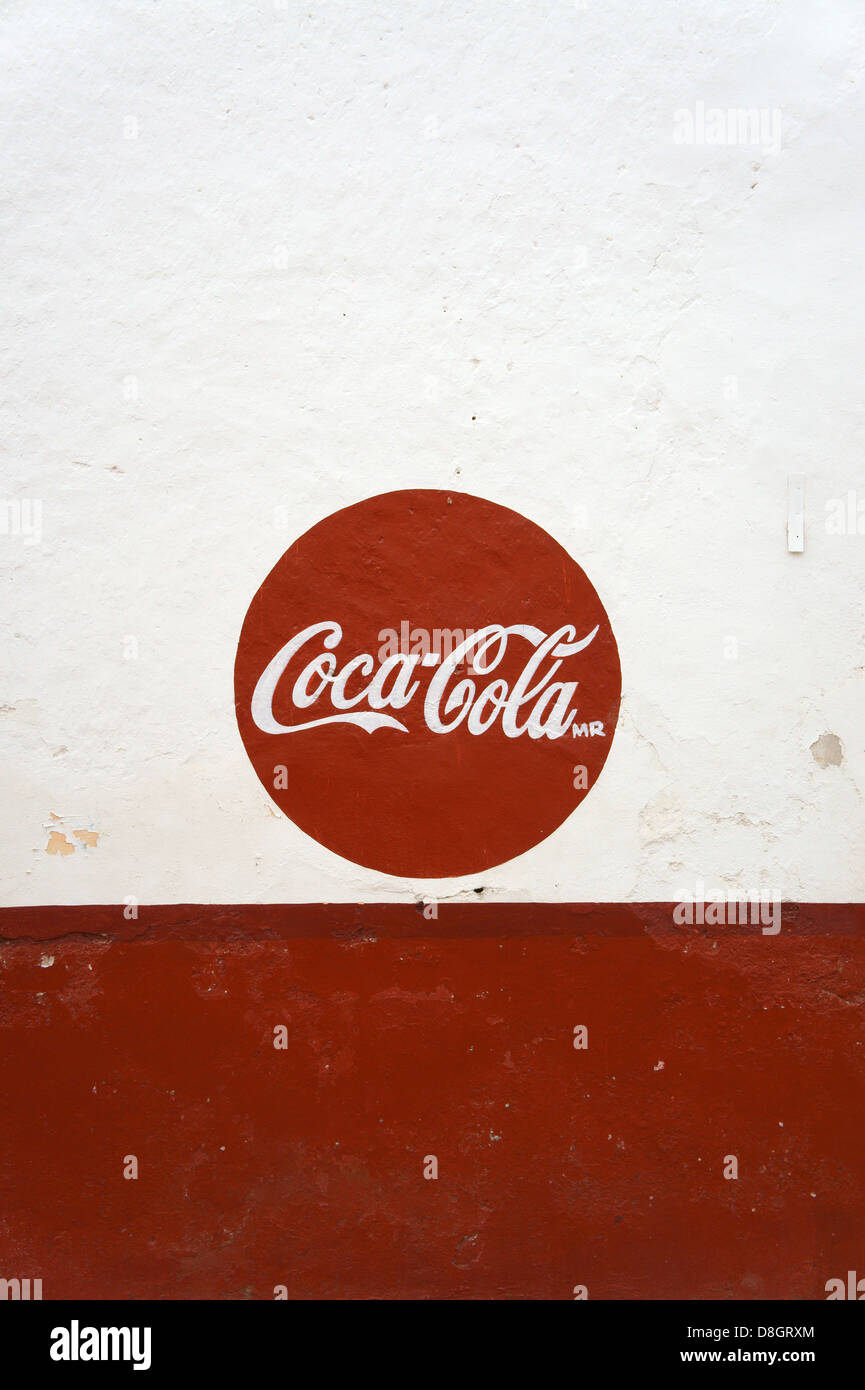 Red and white Coca-Cola sign painted on the wall of a store in Santa Elena, Yucatan, Mexico - Stock Image