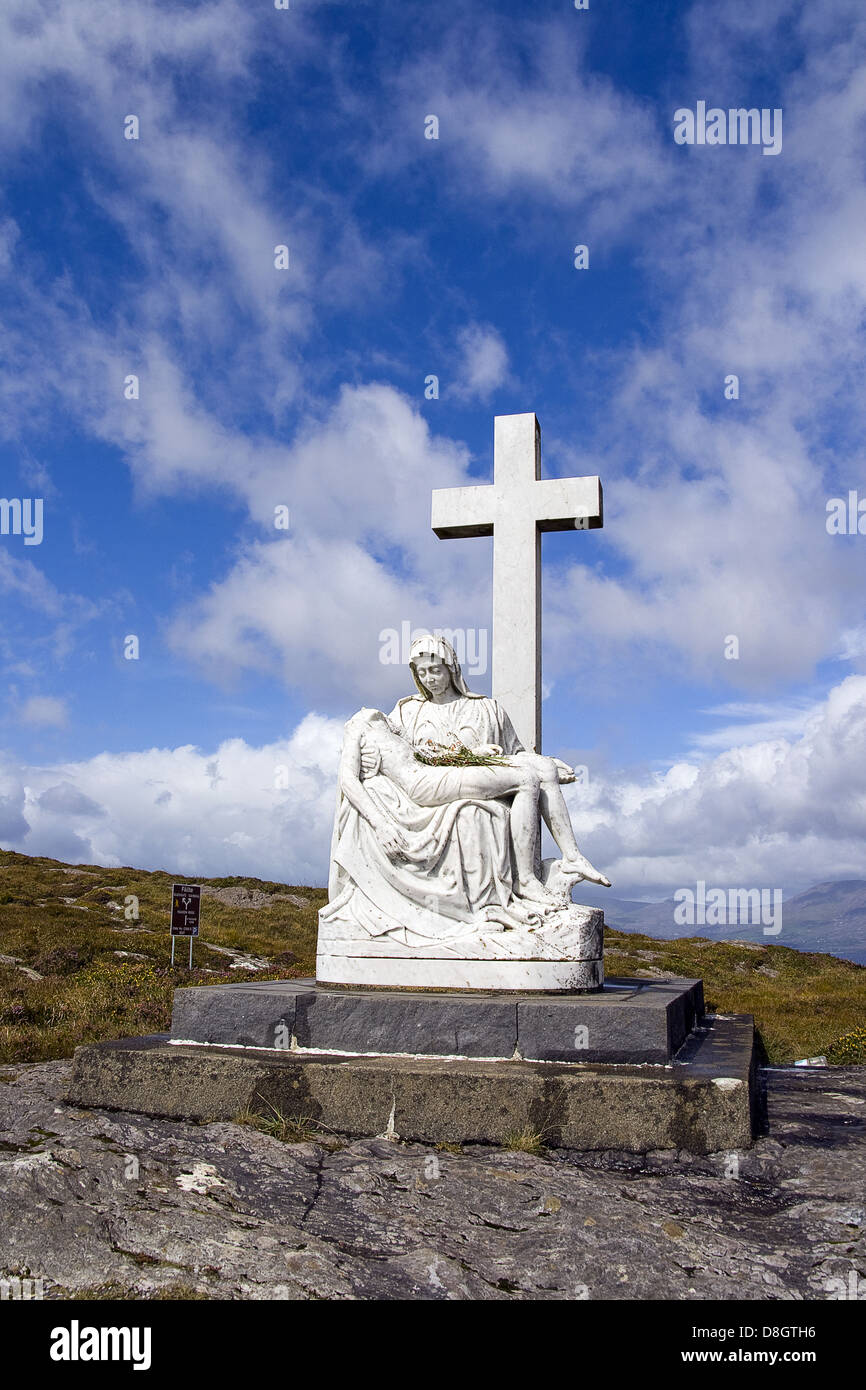Madonna Statue With Holy Cross Stock Photo 56918882 Alamy