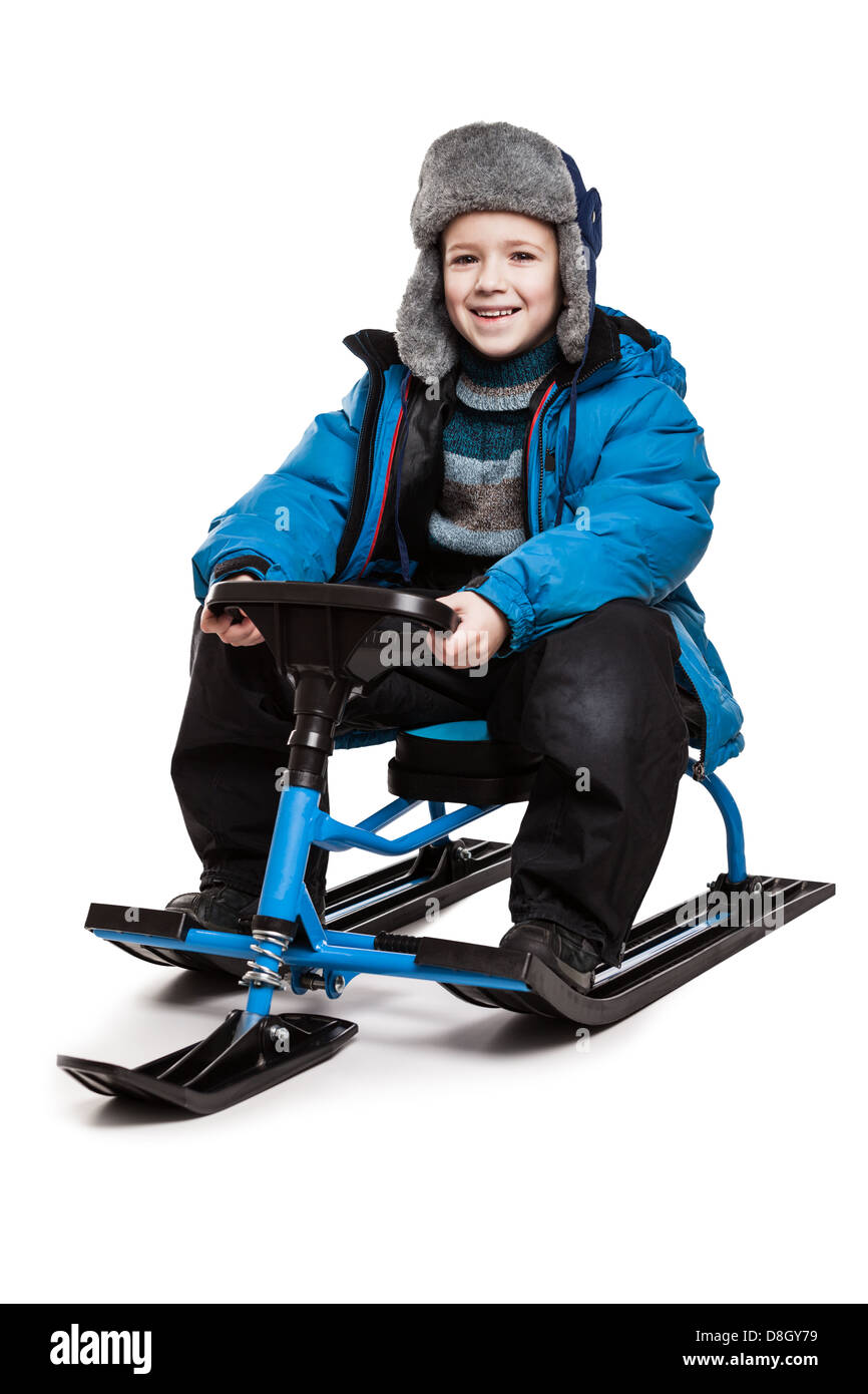 Child on snow scooter or snowmobile toy - Stock Image