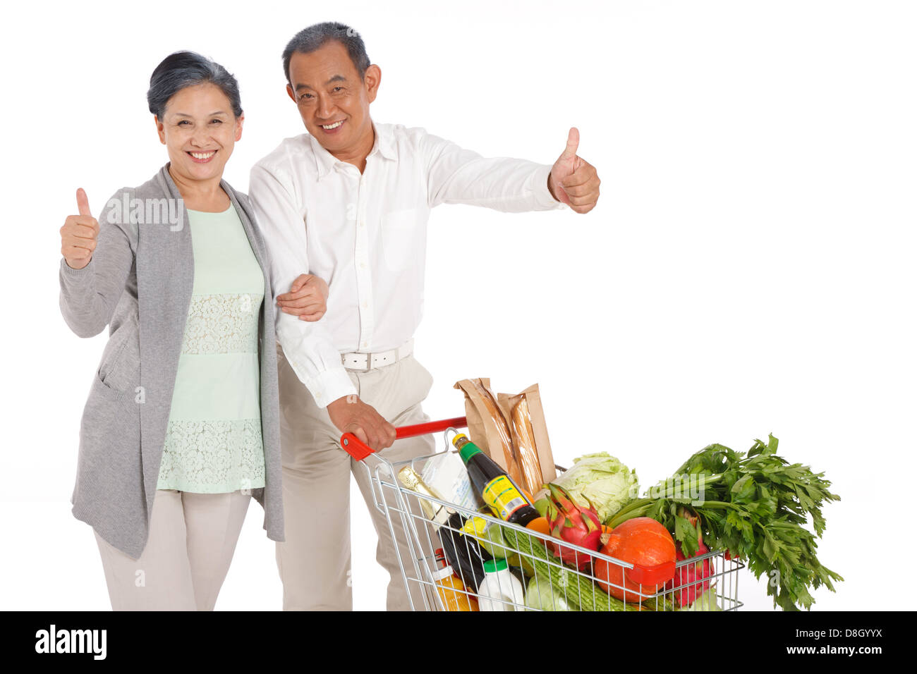 Old couple shopping with shopping cart - Stock Image