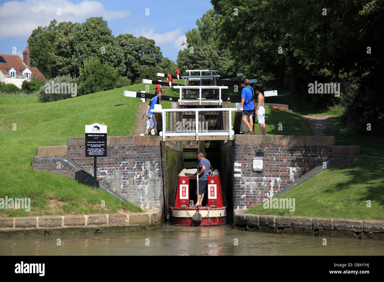 A narrowboat entering Lock 3, the bottom lock of the flight of Watford Locks on the Grand Union Canal - Stock Image