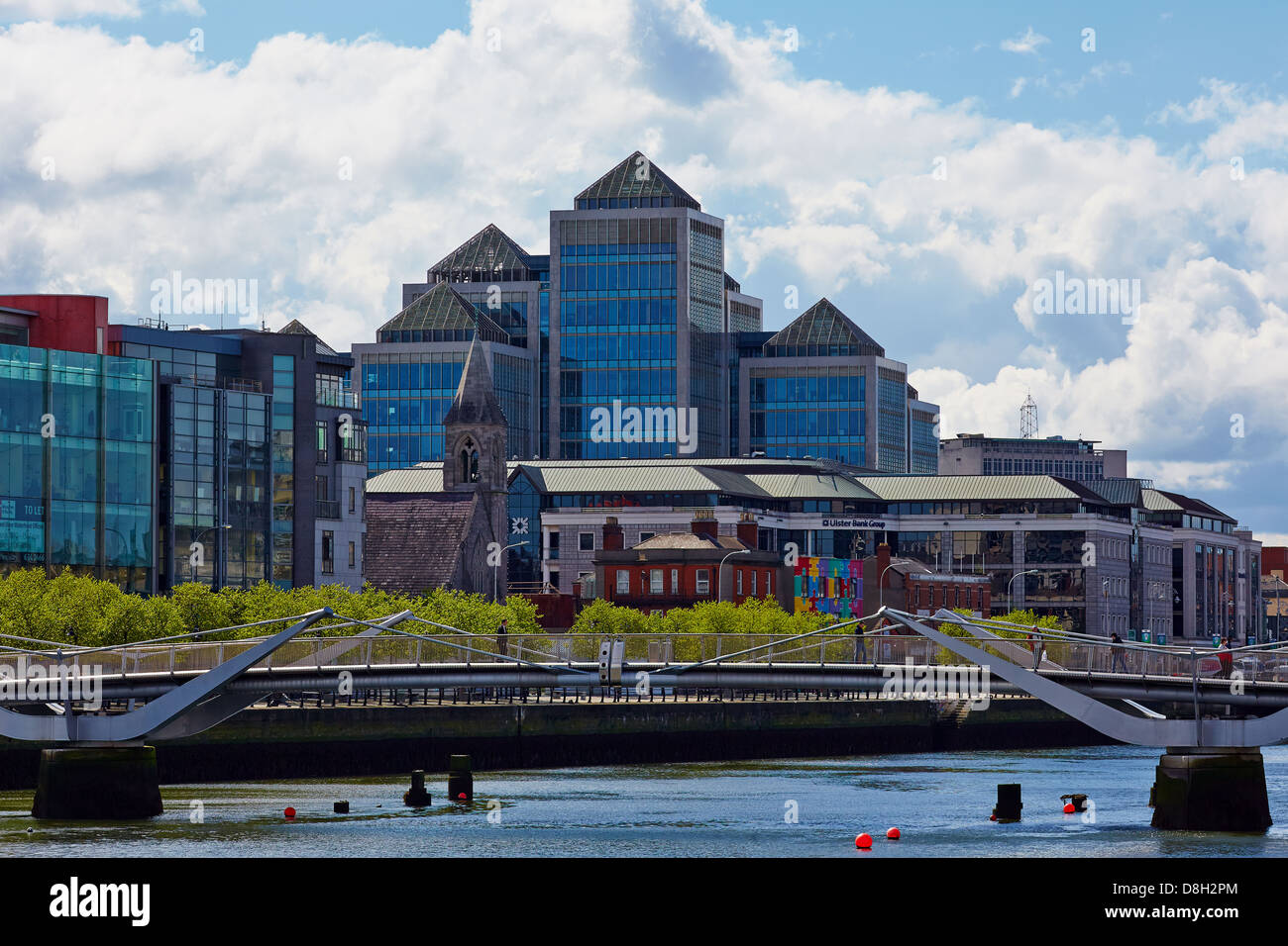 Dublin city skyline showing the Immaculate Heart of Mary church overshadowed by the Ulster bank group HQ on Georges - Stock Image