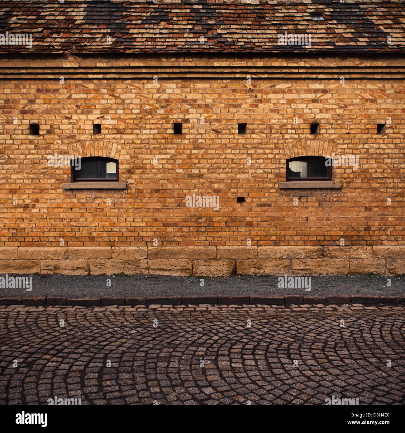 Detail of a brick wall with windows - Stock Image