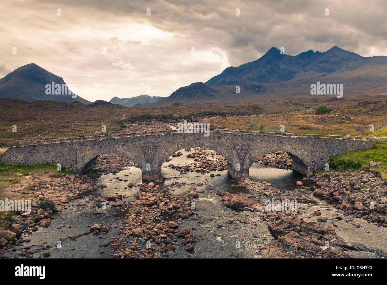 Old Bridge over the River Sligachan in front of the Black Cuilin Hills, Isle of Skye, Scotland Stock Photo
