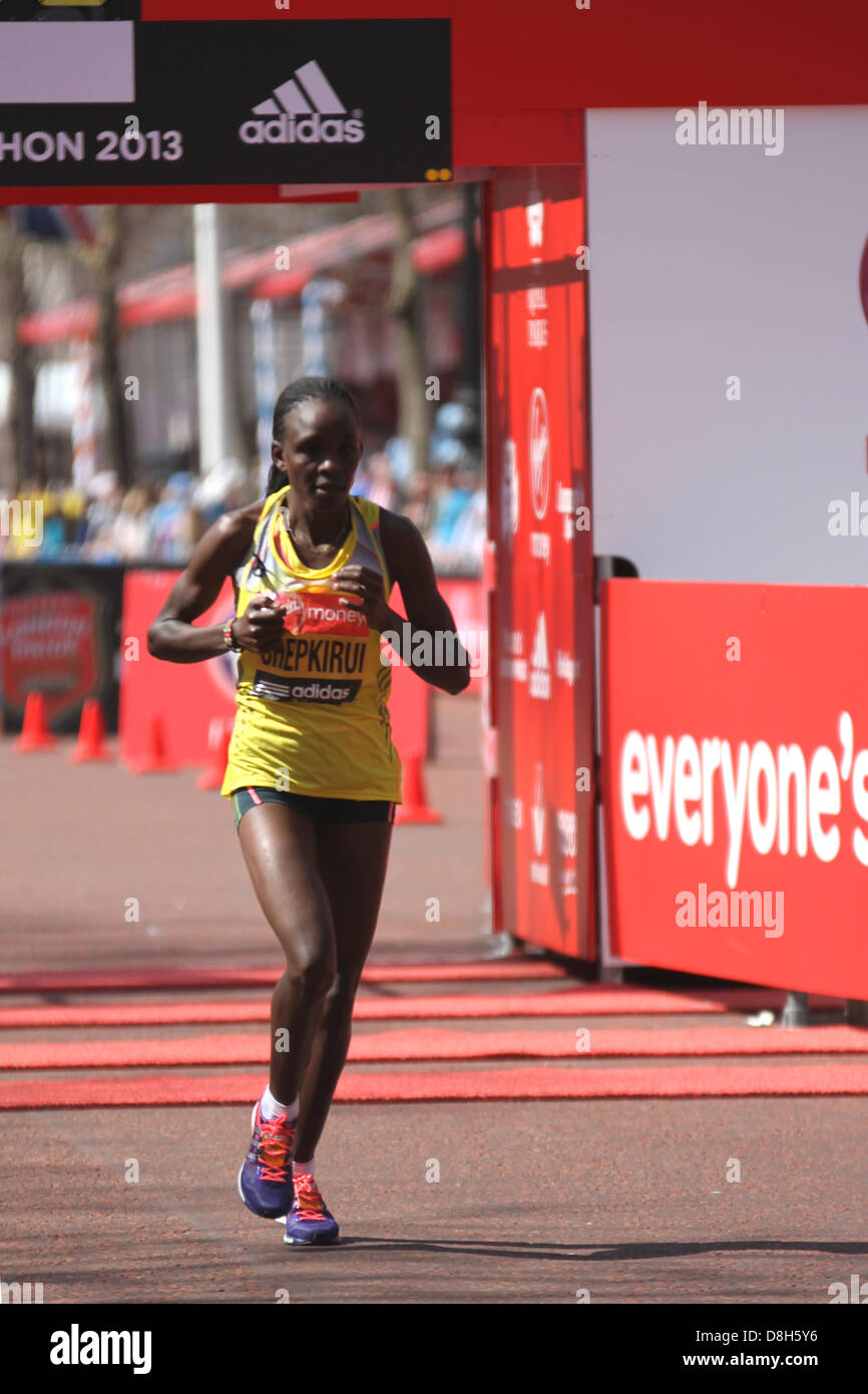 Joyce CHEPKIRUI of Kenya finishes the women's 2013 Virgin London Marathon Stock Photo