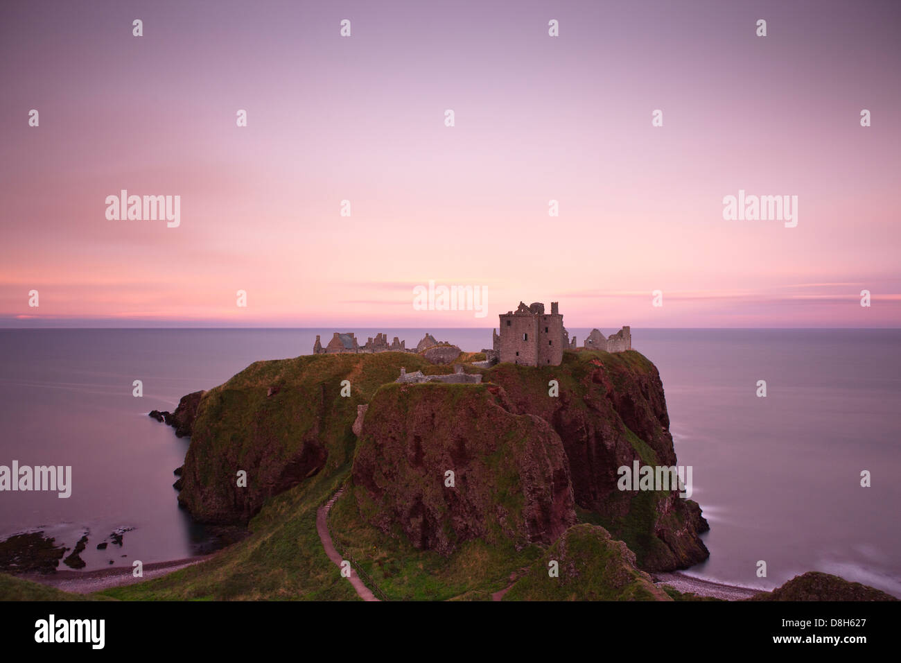 Dunnotar Castle at sunset, Scotland, United Kingdom - Stock Image