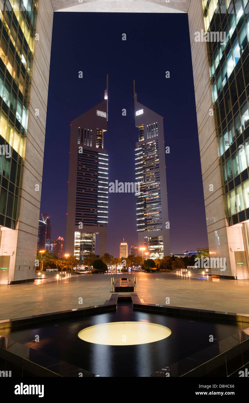 Night view of Emirates towers from The Gate at DIFC or Dubai International Financial Center in Dubai - Stock Image