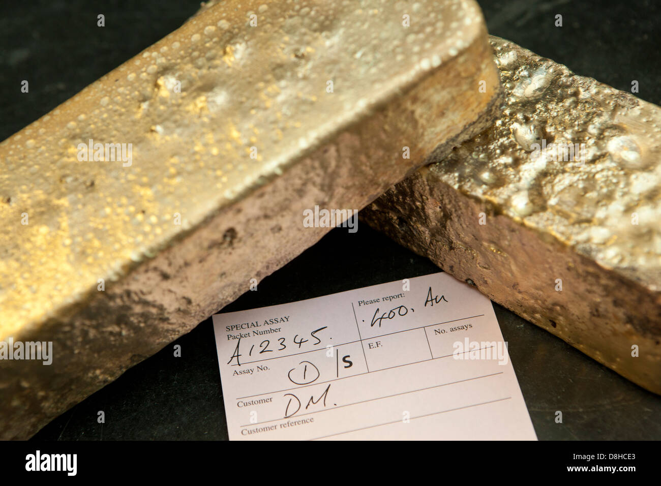 Molten gold bar made from recycled scrap gold at the London Assay Office in Gutter Lane Photo Credit: David Levenson - Stock Image