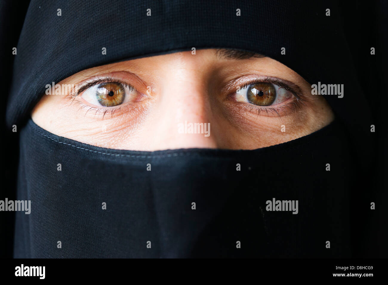 Arab woman wearing traditional black niqab face covering - Stock Image