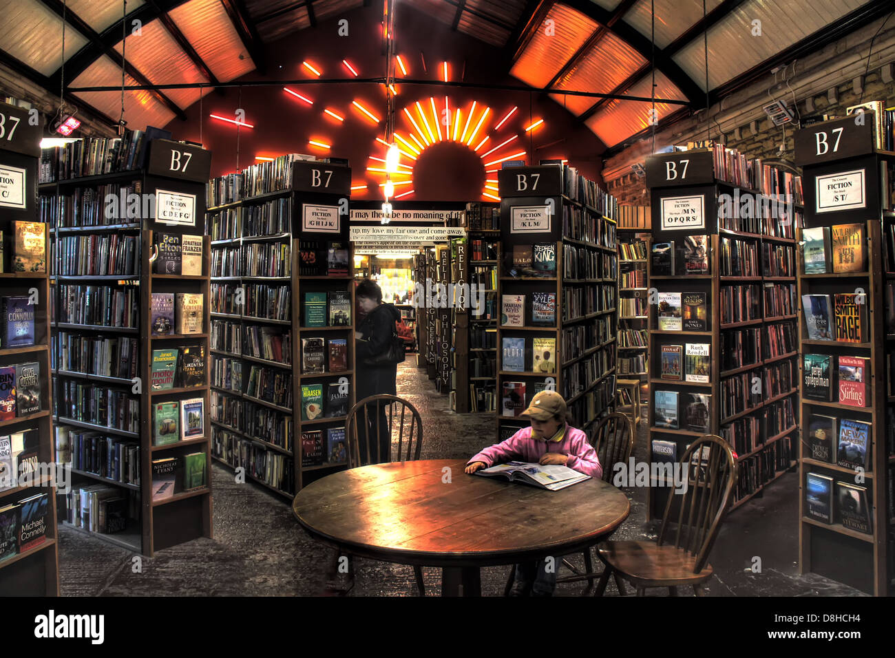 Young person reading at Barter Books Alnwick Northumberland - Stock Image