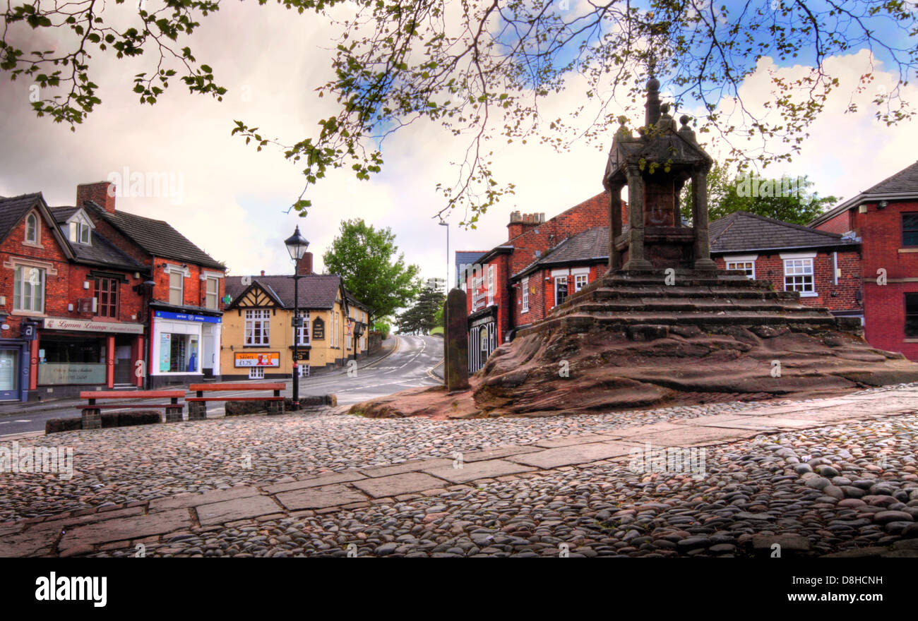 The Cross, Lymm in spring, showing cobbled area and square, Warrington, Cheshire, England, UK - Stock Image