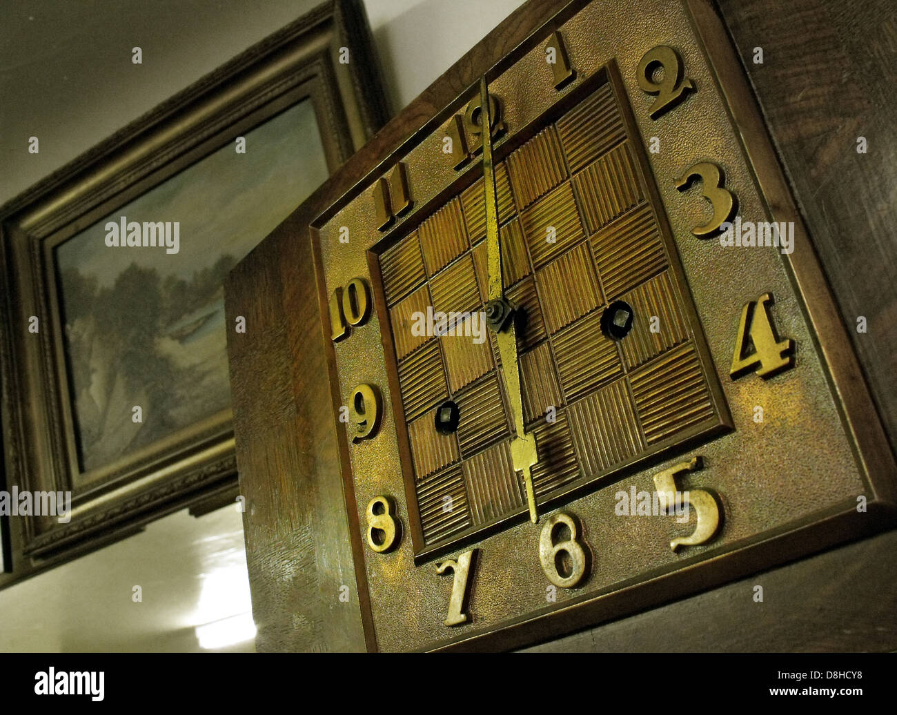 Old Art Deco style clock with hands in brown, England, UK - Stock Image